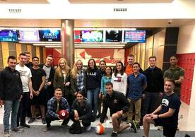 Cadets pose for a picture at a Sacred Heart bowling event