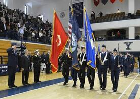 ROTC members holding flags during ceremony